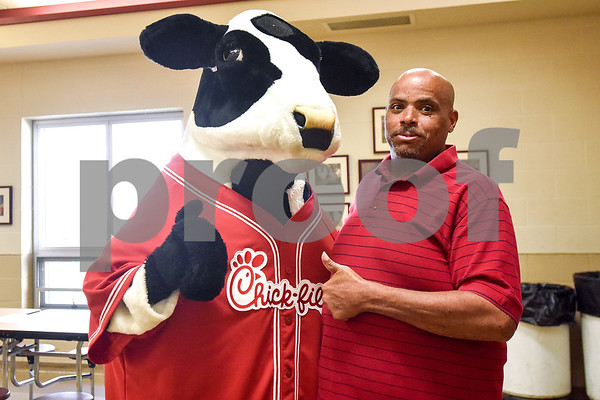 Wesley Moore Jr. poses for a photo with the Chick-fil-A cow at the Salvation Army in Tyler, Texas, on Monday, March 20, 2017. The Chick-Fil-A locations on Broadway Avenue and Troup Highway worked together on a soup drive and raised a total of 5,116 bowls of soup to donate to the Salvation Army. (Chelsea Purgahn/Tyler Morning Telegraph)