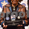 The mother of Anthony D. Broyles holds a plaque in her late son's honor at the annual Smith County Sheriff's Office Awards Dinner at Green Acres Baptist Church in Tyler, Texas, on Tuesday, March 20, 2018. This annual event gives Sheriff Larry Smith the opportunity to spotlight outstanding examples of leadership and excellence in the Sheriff's Office's employees. (Chelsea Purgahn/Tyler Morning Telegraph)