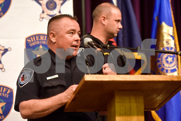 Officrers present awards at the annual Smith County Sheriff's Office Awards Dinner at Green Acres Baptist Church in Tyler, Texas, on Tuesday, March 20, 2018. This annual event gives Sheriff Larry Smith the opportunity to spotlight outstanding examples of leadership and excellence in the Sheriff's Office's employees. (Chelsea Purgahn/Tyler Morning Telegraph)