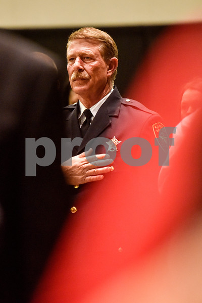An officer stands during the national anthem at the annual Smith County Sheriff's Office Awards Dinner at Green Acres Baptist Church in Tyler, Texas, on Tuesday, March 20, 2018. This annual event gives Sheriff Larry Smith the opportunity to spotlight outstanding examples of leadership and excellence in the Sheriff's Office's employees. (Chelsea Purgahn/Tyler Morning Telegraph)