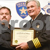 Deputy David Biggs receives a certificate of merit from Sheriff Larry Smith at the annual Smith County Sheriff's Office Awards Dinner at Green Acres Baptist Church in Tyler, Texas, on Tuesday, March 20, 2018. This annual event gives Sheriff Larry Smith the opportunity to spotlight outstanding examples of leadership and excellence in the Sheriff's Office's employees. (Chelsea Purgahn/Tyler Morning Telegraph)