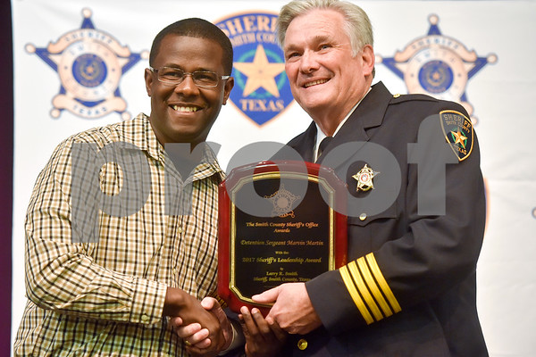 Marvin Martin stands with Larry Smith after being awarded the Sheriff's Leadership Award at the annual Smith County Sheriff's Office Awards Dinner at Green Acres Baptist Church in Tyler, Texas, on Tuesday, March 20, 2018. This annual event gives Sheriff Larry Smith the opportunity to spotlight outstanding examples of leadership and excellence in the Sheriff's Office's employees. (Chelsea Purgahn/Tyler Morning Telegraph)