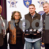 """The parents of the late Anthony D. Broyles, Josh Hill and Sheriff Larry Smith stand together after Hill was presented with the Detective Anthony D. Broyles """"Gentle Giant"""" award at the annual Smith County Sheriff's Office Awards Dinner at Green Acres Baptist Church in Tyler, Texas, on Tuesday, March 20, 2018. This annual event gives Sheriff Larry Smith the opportunity to spotlight outstanding examples of leadership and excellence in the Sheriff's Office's employees. (Chelsea Purgahn/Tyler Morning Telegraph)"""