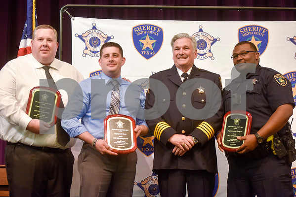 Matt Lazarine, Josh Decur and Jeremy Thompson stand with Sheriff Larry Smith after being awarded the Life Saving Award at the annual Smith County Sheriff's Office Awards Dinner at Green Acres Baptist Church in Tyler, Texas, on Tuesday, March 20, 2018. This annual event gives Sheriff Larry Smith the opportunity to spotlight outstanding examples of leadership and excellence in the Sheriff's Office's employees. (Chelsea Purgahn/Tyler Morning Telegraph)