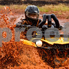 A driver competes in the Polaris Mudda-Cross Competition at Highlifter ATV Mud Nationals in Jacksonville, Texas, on Friday, March 23, 2018. Thousands enjoyed competitions and concerts over the multi-day event. (Chelsea Purgahn/Tyler Morning Telegraph)