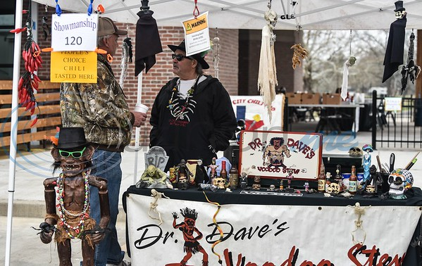 David Trice of Dr. Daves Voodoo Stew chats with a customer at his booth during the 38th Rose City Chili Pod Cook-Off. The event took place at the Texas Music City Grill & Smokehouse in Lindale on Saturday, March 2. (Jessica T. Payne/Tyler Morning Telegraph)