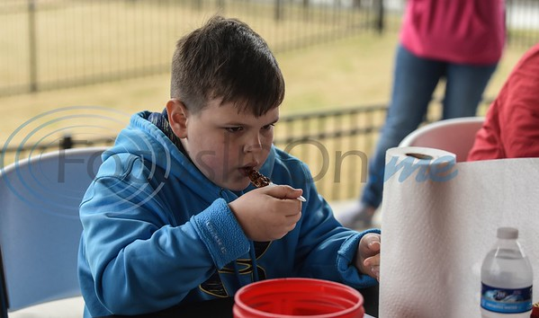 Logan Batton (8) of Jacksonville judges chili at the 38th Rose City Chili Pod Cook-Off on Saturday, March 2. The event took place at the Texas Music City Grill & Smokehouse in Lindale and included beans, junior division age 7-17 and CASI chili cook-off categories. (Jessica T. Payne/Tyler Morning Telegraph)