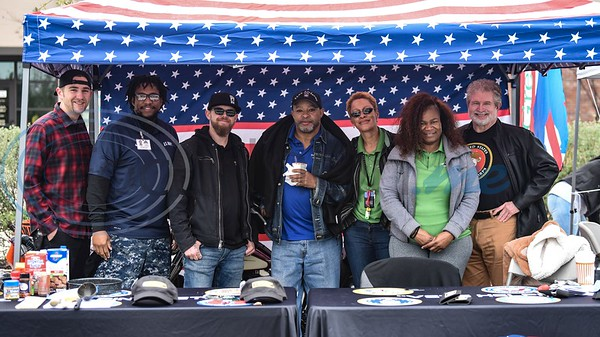 Veterans (from left to right) Justin Case, Marlondo Fiddo, Jeff Hurley, Reginald Wilbert, Felicia Lilly, Betty Currington and Tom Thompson smile for a photo at their booth at the 38th Rose City Chili Pod Cook-Off. The event took place at the Texas Music City Grill & Smokehouse in Lindale on Saturday, March 2. (Jessica T. Payne/Tyler Morning Telegraph)