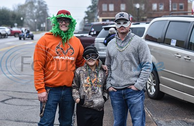 (From left to right) Jonathan Williams (18), Aidyn Pyle (8) and Matthew Pyle (27) stop for a photo while attending the Rusk Mardi Gras Parade in downtown Rusk on Saturday, March 2. The event marked the first for Rusk and included the parade, gumbo contest and several family friendly activities. (Jessica T. Payne/Tyler Morning Telegraph)