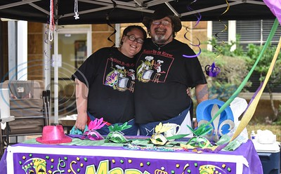 Lorinda Chancelor (left) and Oley Willis (right) of Kajun Roux Krew smile for a photo during the inaugural Rusk Mardi Gras Parade on Saturday, March 2. The event took place in downtown Rusk and included a King Cake competition, car show, live music, bounce house , face painting and more. (Jessica T. Payne/Tyler Morning Telegraph)