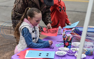Chloey Baker (6) does crafts at the Rusk Mardi Gras Parade in downtown Rusk on Saturday, March 2. The event marked the first for Rusk and included the parade, gumbo contest and several family friendly activities. (Jessica T. Payne/Tyler Morning Telegraph)