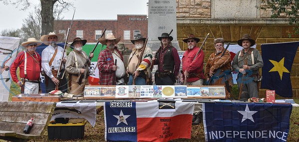 Cherokee volunteers of the Alamo Era Re-enactors honor Texas heroes at the first ever family-friendly Mardi Gras in Rusk. The event took place in downtown Rusk on Saturday, March 2 and included a King Cake competition, car show, live music, bounce house , face painting and more. (Jessica T. Payne/Tyler Morning Telegraph)