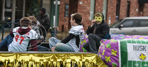 Children from the Rusk Youth Sports Association ride in the inaugural Mardi Gras Parade on Saturday, March 2. The event marked the first for Rusk and included the parade, gumbo contest and several family friendly activities. (Jessica T. Payne/Tyler Morning Telegraph)