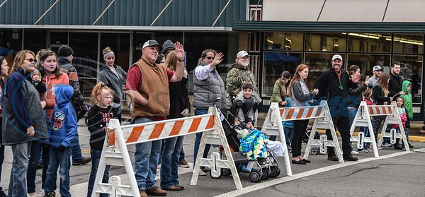 Families wave during the Rusk Mardi Gras Parade in downtown Rusk on Saturday, March 2. The event marked the first for Rusk and included the parade, gumbo contest and several family friendly activities. (Jessica T. Payne/Tyler Morning Telegraph)