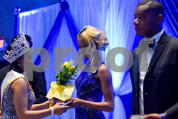 Janae Jennings receives her award for first place during the Mr. and Miss Jarvis Pageant at Jarvis Christian College in Hawkins, Texas, on Wednesday, March 22, 2017. The pageant featured personal style, professional attire, an oral presentation, formal wear, and question and answer rounds. (Chelsea Purgahn/Tyler Morning Telegraph)