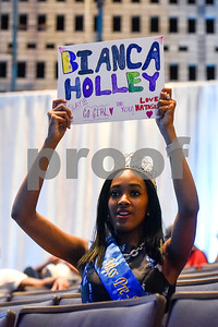 Natasha holds up a sign during the Mr. and Miss Jarvis Pageant at Jarvis Christian College in Hawkins, Texas, on Wednesday, March 22, 2017. The pageant featured personal style, professional attire, an oral presentation, formal wear, and question and answer rounds. (Chelsea Purgahn/Tyler Morning Telegraph)