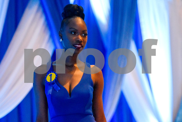 Zenovia Hawkins Osaghae walks across the stage during the Mr. and Miss Jarvis Pageant at Jarvis Christian College in Hawkins, Texas, on Wednesday, March 22, 2017. The pageant featured personal style, professional attire, an oral presentation, formal wear, and question and answer rounds. (Chelsea Purgahn/Tyler Morning Telegraph)