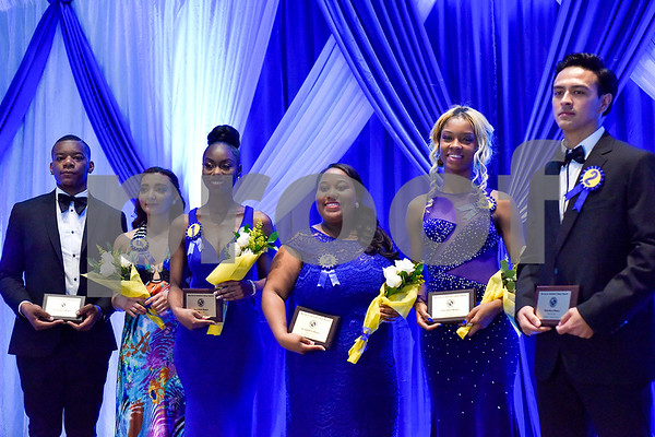 Contestants pose for a photo during the Mr. and Miss Jarvis Pageant at Jarvis Christian College in Hawkins, Texas, on Wednesday, March 22, 2017. The pageant featured personal style, professional attire, an oral presentation, formal wear, and question and answer rounds. (Chelsea Purgahn/Tyler Morning Telegraph)