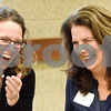 Michelle Bosworth and JoAnne Idell laugh at the Women in Tyler Luncheon at the Tyler Rose Garden Center in Tyler, Texas, on Thursday, March 22, 2018. Six women were honored for their work in Tyler. (Chelsea Purgahn/Tyler Morning Telegraph)