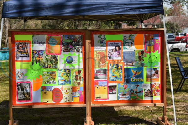 A Happy Wall stands on display with words of encouragement and information as part of an event celebrating the 6th annual International Day of Happiness. The event was held on March 23 at Bergfeld Park. (Jessica T. Payne/Tyler Morning Telegraph)
