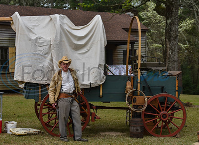"""Shelley """"Shamrock"""" Cleaver of Jacksonville stands in costume next to a covered wagon displayed at the Inaugural Hogg Fest in Rusk on Saturday, March 23. The event was hosted by the Rusk Chamber of Commerce and was held at Jim Hogg Park.  (Jessica T. Payne/Tyler Morning Telegraph)"""