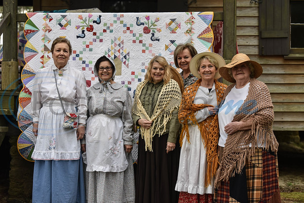 (From left to right front) Sarah Welch, Sandy Lindsey, Jackie Sessions, Jo Caraway and Bonnie Nichol and (back) Sandra Sanders stand in time period attire at the Quit Show as part of the Inaugural Hogg Fest in Rusk. The event was held at Jim Hogg Park on March 23 and was hosted by the Rusk Chamber of Commerce. (Jessica T. Payne/Tyler Morning Telegraph)