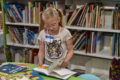 Lola Felder, 6, reads a book in the new Children's Section of the Stella Hill Memorial Library during the Stella Memorial Library during its Grand Reopening on Sunday, March 24. The library also added a Teen and Adult Section. (Jessica T. Payne/Tyler Morning Telegraph)
