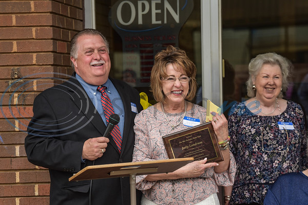 Guest speaker and Alto native Judge Chris Davis presents Alto Study Club President Judy Landrum with a Plaque of Appreciation for her dedication to the renovations of the Stella Hill Memorial Library during their Grand Reopening on Sunday, March 24. (Jessica T. Payne/Tyler Morning Telegraph)