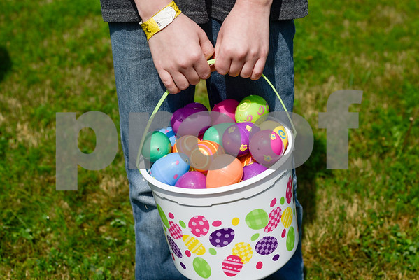 Jason Fowler, 10, holds a basket full of eggs during an Easter egg hunt at the Boys and Girls Club of East Texas in Tyler, Texas, on Thursday, March 29, 2018. (Chelsea Purgahn/Tyler Morning Telegraph)