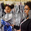 Ta'Dasia Green and LaToyia Session-Jordan look at a dress at the GlamProm Dress Closet Expo at Cindy's Event Center in Tyler, Texas, on Friday, March 30, 2018. The I Am Beautiful Movement hosted the event to provide free prom dresses and accessories for high school girls. (Chelsea Purgahn/Tyler Morning Telegraph)