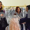 Alesha Sanchez, Jasmine Sanchez and Shandral Shankle look at a dress at the GlamProm Dress Closet Expo at Cindy's Event Center in Tyler, Texas, on Friday, March 30, 2018. The I Am Beautiful Movement hosted the event to provide free prom dresses and accessories for high school girls. (Chelsea Purgahn/Tyler Morning Telegraph)