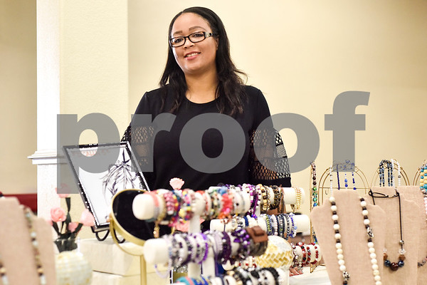 Tamica Dale poses for a photo with her handmade jewelry at her booth at the GlamProm Dress Closet Expo at Cindy's Event Center in Tyler, Texas, on Friday, March 30, 2018. The I Am Beautiful Movement hosted the event to provide free prom dresses and accessories for high school girls. (Chelsea Purgahn/Tyler Morning Telegraph)