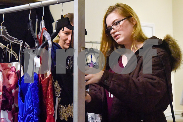 Kenzie Bramblett, right, looks at dresses at the GlamProm Dress Closet Expo at Cindy's Event Center in Tyler, Texas, on Friday, March 30, 2018. The I Am Beautiful Movement hosted the event to provide free prom dresses and accessories for high school girls. (Chelsea Purgahn/Tyler Morning Telegraph)