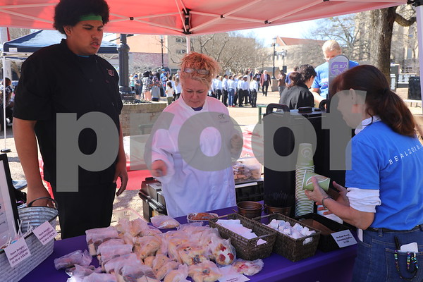 TISD Culinary students sell donuts and pastries at the Coffee and Donuts Festival, Downtown Sqaure.