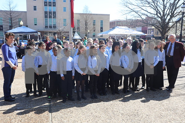 Dr. Aubrey Sharpe poses with a student choir from Big Sandy ISD at the Coffee and Donuts Festival, Downtown Sqaure.