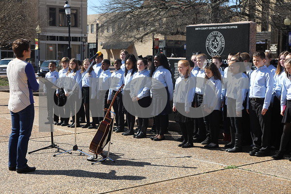 Student choir from Big Sandy ISD perform at the Coffee and Donuts Festival, Downtown Square.