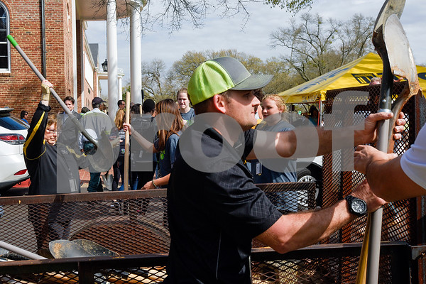 Stan Borel, right, hands people shovels during an Arbor Day event at Tyler Junior College in Tyler, Texas, on Monday, March 5, 2018. Tyler Junior College, the Tyler Trees Committee, Keep Tyler Beautiful and the Tyler Parks and Recreation Department hosted a tree planting event to celebrate Arbor Day. (Chelsea Purgahn/Tyler Morning Telegraph)
