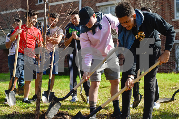 Tyler Junior College soccer players help plant a tree at an Arbor Day event at Tyler Junior College in Tyler, Texas, on Monday, March 5, 2018. Tyler Junior College, the Tyler Trees Committee, Keep Tyler Beautiful and the Tyler Parks and Recreation Department hosted a tree planting event to celebrate Arbor Day. (Chelsea Purgahn/Tyler Morning Telegraph)