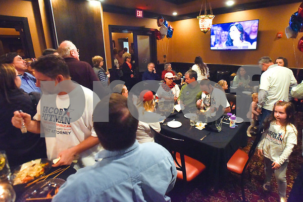 People chat and eat during a primary election night watch party for Jacob Putman at Dakota's in Tyler, Texas, on Tuesday, March 6, 2018. (Chelsea Purgahn/Tyler Morning Telegraph)