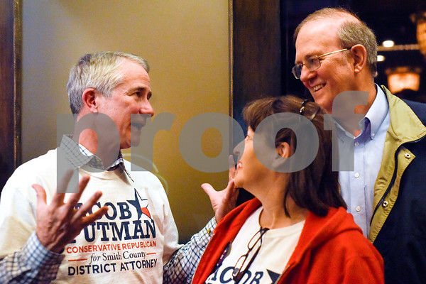 Jerry Putman chats with Karen and Dr. Lloyd Olsen during a primary election night watch party for Jerry's son Jacob Putman at Dakota's in Tyler, Texas, on Tuesday, March 6, 2018. (Chelsea Purgahn/Tyler Morning Telegraph)