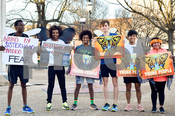 """Simon Gachibi, Haftu Knight, Nick Knight, Jack Gipson, Cesar Correa and Dalila Reynoso pose for a photo during a """"Migration is Beautiful"""" event at T.B. Butler Fountain Plaza in Tyler, Texas, on Tuesday, March 6, 2018. The event, themed around the migrant monarch butterfly, was in support of Dreamers and other immigrants. (Chelsea Purgahn/Tyler Morning Telegraph)"""