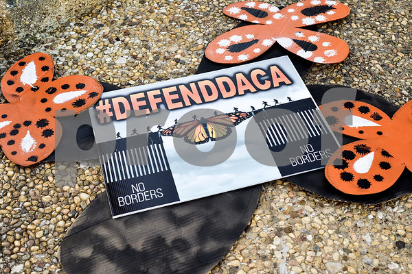 """A decorated sign at a """"Migration is Beautiful"""" event at T.B. Butler Fountain Plaza in Tyler, Texas, on Tuesday, March 6, 2018. The event, themed around the migrant monarch butterfly, was in support of Dreamers and other immigrants. (Chelsea Purgahn/Tyler Morning Telegraph)"""