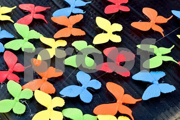 """Decorative butterflies on a sign during a """"Migration is Beautiful"""" event at T.B. Butler Fountain Plaza in Tyler, Texas, on Tuesday, March 6, 2018. The event, themed around the migrant monarch butterfly, was in support of Dreamers and other immigrants. (Chelsea Purgahn/Tyler Morning Telegraph)"""