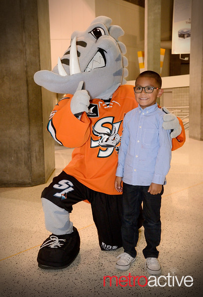 Frenzy (San Jose Barracuda Mascot) poses with Sharks fan