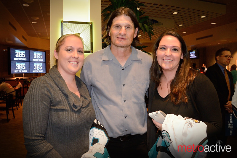 Sharks Development coach Mike Ricci (c) poses with fans