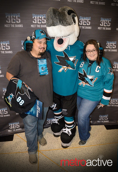 Sharkie is bookended by two fans