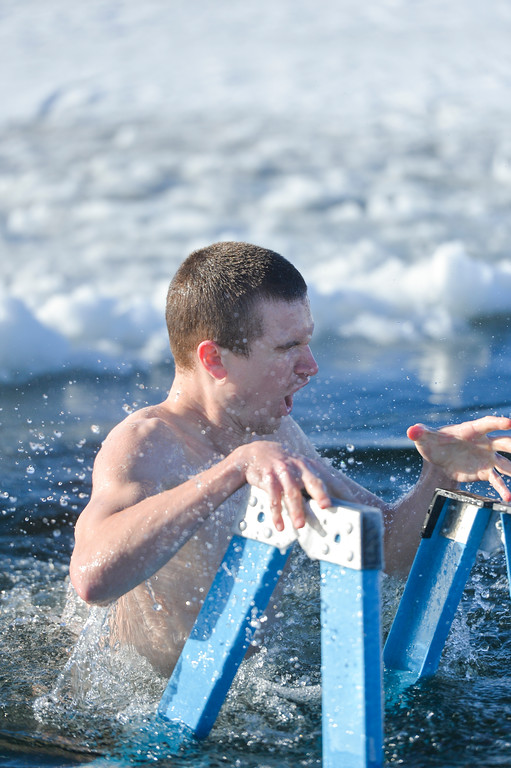 Ashleigh Fox | The Sheridan Press <br /> The Sheridan Press' Bud Denega reacts after submerging into the Lake DeSmet Polar Plunge hole Jan. 1, 2018.