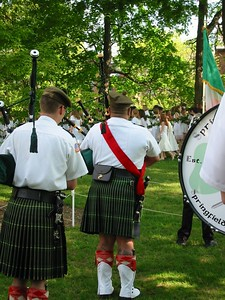 Pipers play as Laurel Chain in placed around Mary Lyon's grave.