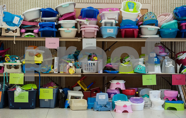 Baby items such as bathtubs, training potties and feeding chairs fill shelves at Harvey Convention Center in Tyler on Wednesday April 11, 2018 for the upcoming CCC Sale. The CCC Sale is a consignment sale with items from over 1,400 families including children's clothes, home decor, baby items, bicycles and even furniture. The sale is open April 12-14. Items that don't sell either go back to the owner or are donated to charity.   (Sarah A. Miller/Tyler Morning Telegraph)