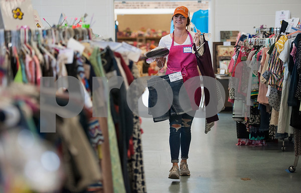 Volunteer Alyssa Diamond puts clothing on their correct racks to prepare for the CCC Sale at Harvey Convention Center in Tyler on Wednesday April 11, 2018. The CCC Sale is a consignment sale with items from over 1,400 families including children's clothes, home decor, baby items, bicycles and even furniture. The sale is open April 12-14. Items that don't sell either go back to the owner or are donated to charity.   (Sarah A. Miller/Tyler Morning Telegraph)